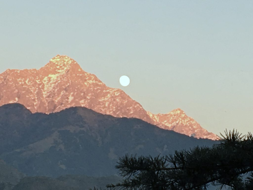 The nearly-full Moon rose up over the Himalayas at McLeod Ganj, Himachal Pradesh, India